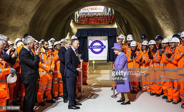Queen Elizabeth unveils the new roundel for the Crossrail line next toTerry Morgan Chairman of Crossrail and London's mayor Boris Johnson during a...