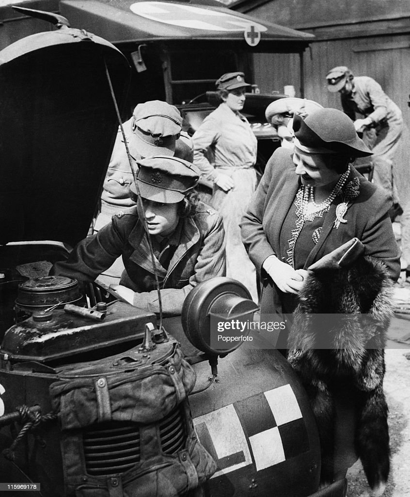 Queen Elizabeth visits her daughter Princess Elizabeth, who is training as an ATS mechanic at a training centre in southern England, April 1945. At this stage she is a Second Subaltern of the ATS (Auxiliary Territorial Service).