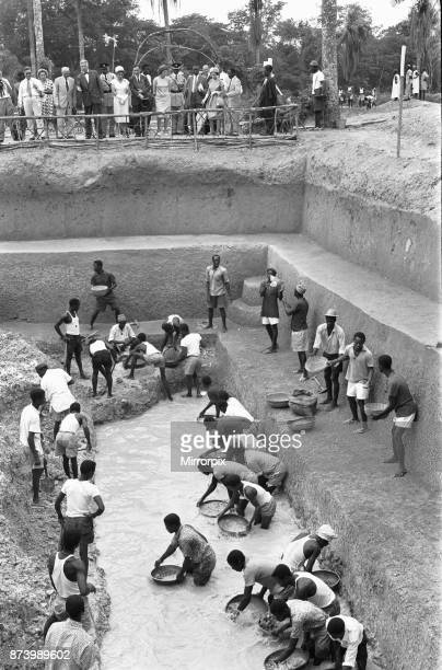 Queen Elizabeth watches work in progress during a visit to the alluvial diamond workings at Hangha in Kenema, an eastern province of Sierra Leone,...