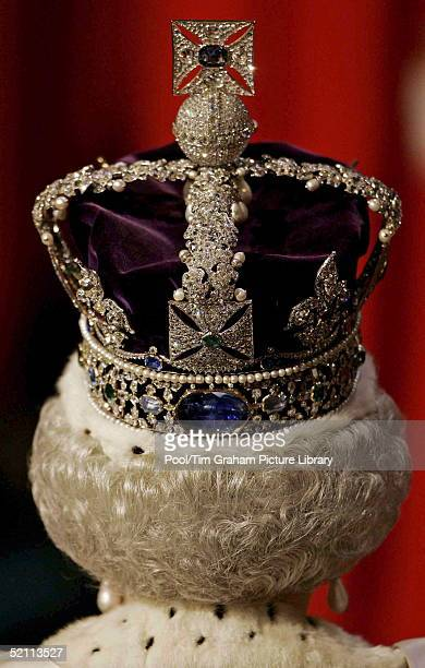Queen Elizabeth Wears The Imperial Crown As She Walks Through The Royal Gallery In The House Of Lords During The State Opening Of Parliament.