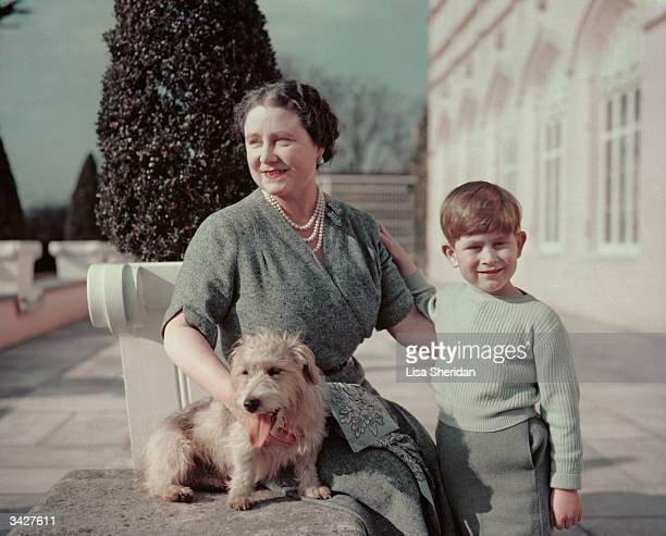 Queen Elizabeth wife of George VI with her grandson Prince Charles and Pippin the dog