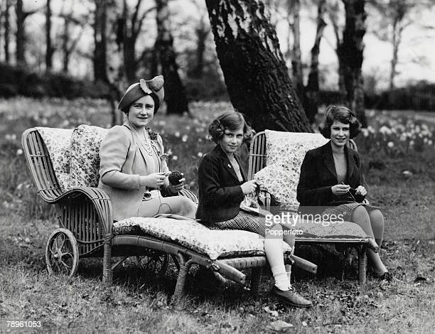 Queen Elizabeth with her two daughters Princess Elizabeth and Princess Margaret as they take part in knitting to help with war charities during World...
