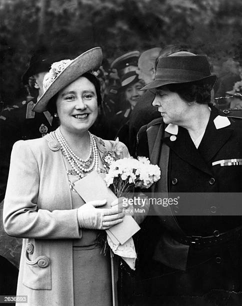 Queen Elizabeth with Queen Marie of Yugoslavia widow of King Alexander I of Yugoslavia during a summer fair held in the grounds of Clarence House...