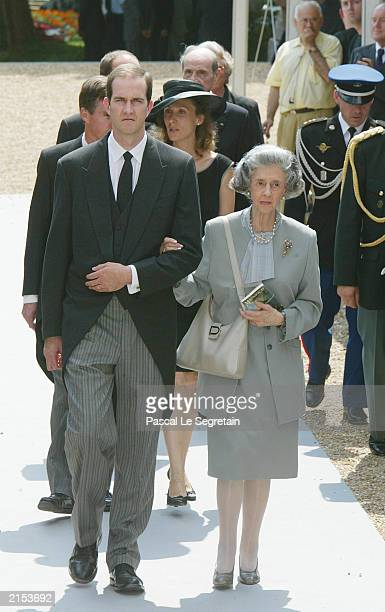 Queen Fabiola of Belgium arrives with Prince Eudes of France to attend the funeral of his mother the Countess of Paris July 11 2003 in Dreux which is...