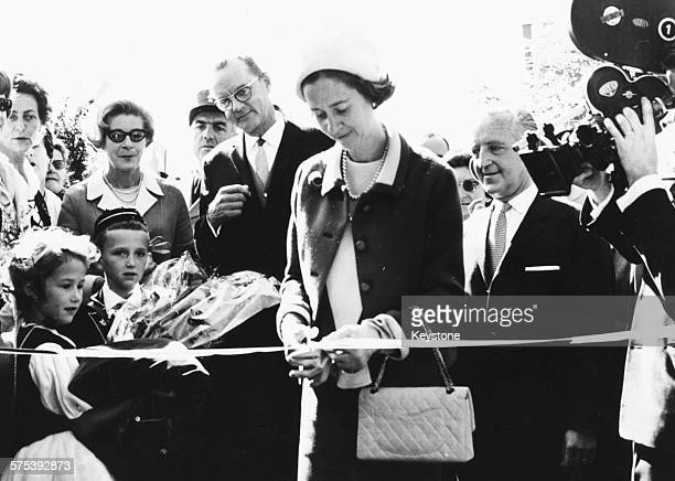 Queen Fabiola of Belgium cutting the ribbon at the inauguration of the new Christian holiday centre at Leysin October 14th 1967