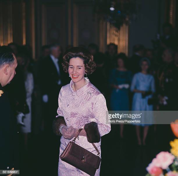 Queen Fabiola of Belgium pictured wearing a pink jacket with fur lined cuffs and matching skirt at a New Year reception at the Royal Palace in...