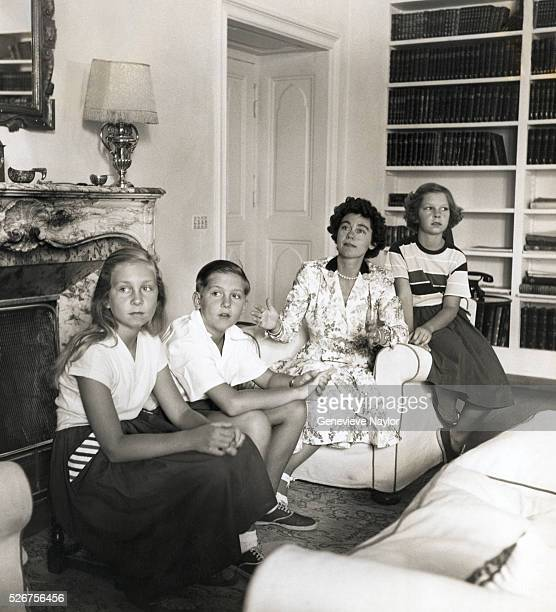 Queen Frederica of Greece sits with her children, Constantine, Irini, and Sophia. Constantine later ruled Greece as King from 1964 to 1974, and...
