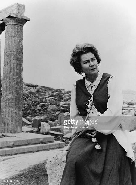 Queen Frederika wearing the national costume at to the ruins of the Apollo temple in the region of Peloponnese in Greece on May 15, 1963.