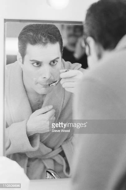 Queen frontman Freddie Mercury shaving his moustache 12th April 1984