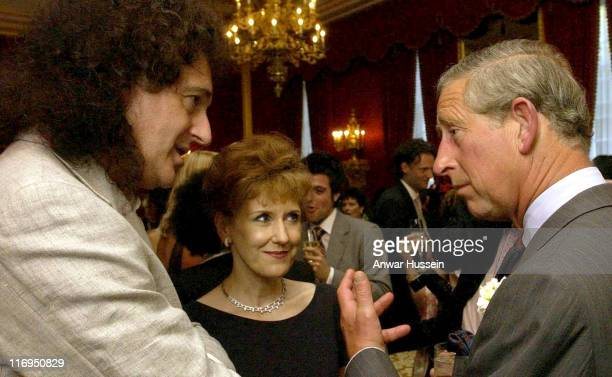 Queen guitarist Brian May and actress Anita Dobson chat to the Prince of Wales at a Summer party held at St James's Palace on July 26 2004 in London...
