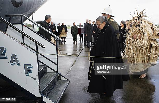 Queen Halaevalu Mata'aho wife of the Late Tongan King Taufa'ahau Tupou IV waits at the steps of the plane before boarding the Hercules to take her...