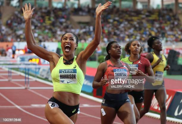 Queen Harrison of the US celebrates after victory in the women's 100 metres hurdles during the IAAF Diamond League athletics 'Herculis' meeting at...