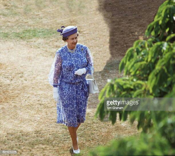 Queen In The Grounds Of Buckingham Palace While Hosting A Garden Party