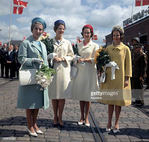 Queen Ingrid of Denmark holding a bouquet of flowers with her daughters, Princess Margrethe, Princess Benedikte, and Princess Anne-Marie, in Randers,...