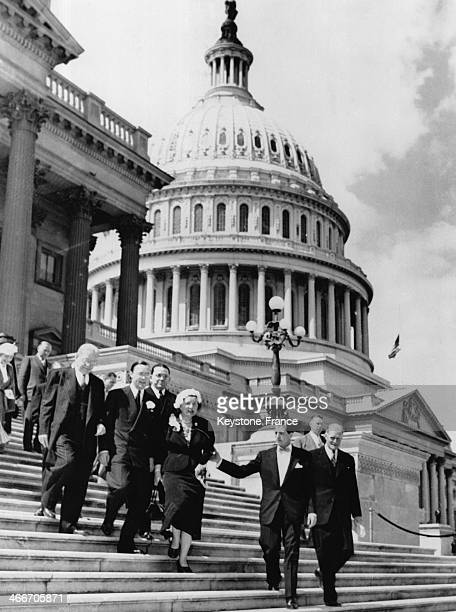 Queen Juliana and Prince Bernhard being escorted down the steps after visiting the Senate building on April 8 1952 in Washigton DC