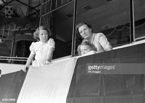 Queen Juliana of the Netherlands and her daughters Princess Beatrix and Princess Irene watch the riding at the International Horse Show in White City...