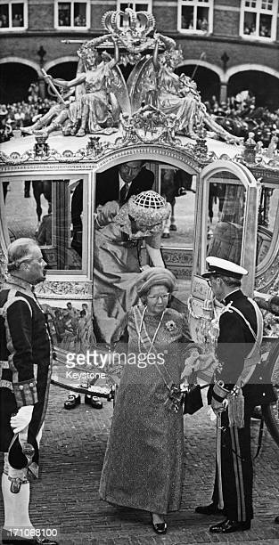 Queen Juliana of the Netherlands and Prince Bernhard arriving for the state opening of the Dutch Parliament in The Hague, 18th September 1973. Behind...