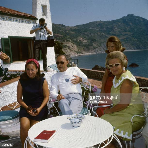 Queen Juliana of the Netherlands and Prince Bernhard with their daughters Princess Irene and Princess Margriet at Porto Ercole.