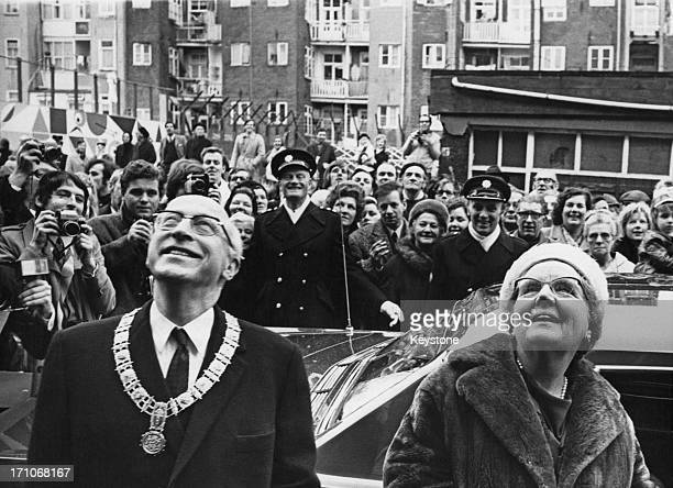 Queen Juliana of the Netherlands and the mayor of Amsterdam, Ivo Samkalden viewing buildings in a working class district of the city, 22nd January...