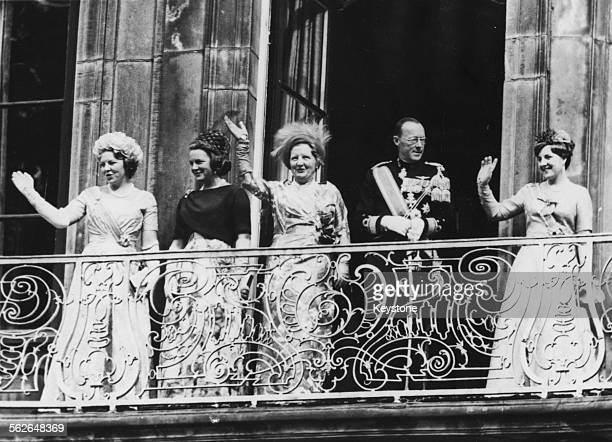 Queen Juliana of the Netherlands and the rest of the Royal Family waving from the balcony Princess Beatrix Princess Irene Prince Bernhard and...