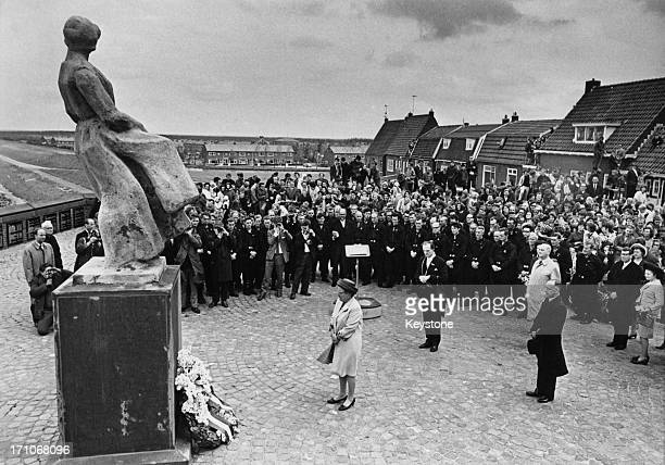 Queen Juliana of the Netherlands at the unveiling of a monument to dead fishermen in Urk, Flevoland province, Netherlands, during celebrations of the...