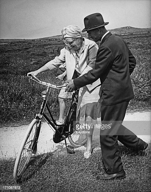 Queen Juliana of the Netherlands goes for a cycle ride during a visit to De Bosplaat nature reserve on the West Frisian Island of Terschelling...