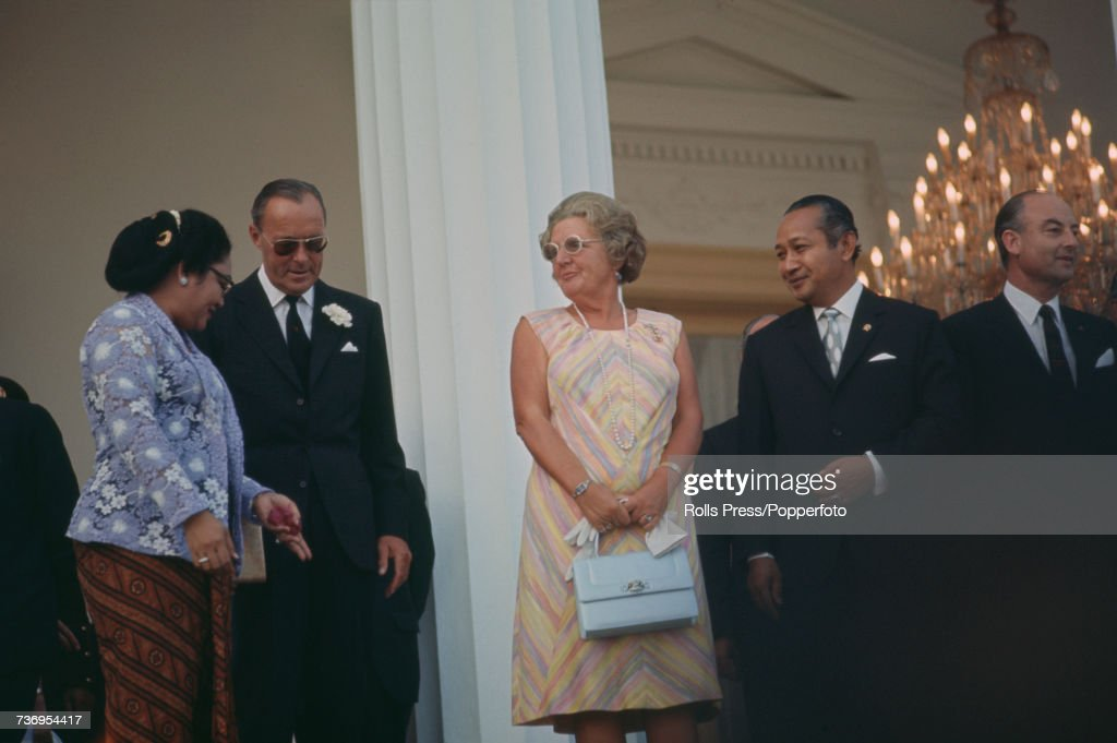Queen Juliana of the Netherlands (1909-2004), pictured in centre with her husband Prince Bernhard of Lippe-Biesterfeld (1911-2004), are welcomed by President Suharto of Indonesia (1921-2008), on right, and Siti Hartinah (1923-1996), on left, during a visit by the Dutch royal couple to Jakarta, Indonesia on 2nd September 1971.