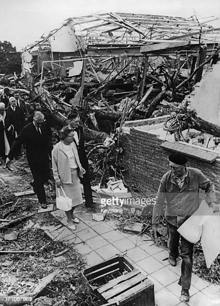 Queen Juliana of the Netherlands visits Tricht, in Gelderland province, two days after the village was hit by a tornado, Netherlands, 27th June 1967....