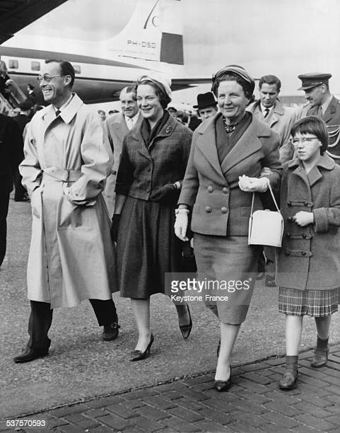 Queen Juliana with Princessses Marijke and Irene welcome prince Berhard who comes back from a trip to South America at the airport on November 9 1959...