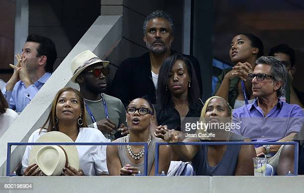 Queen Latifah and Eboni Nichols, above Rick Fox and daughter Sasha Fox cheer for their friend Serena Williams during day 10 of the 2016 US Open at...