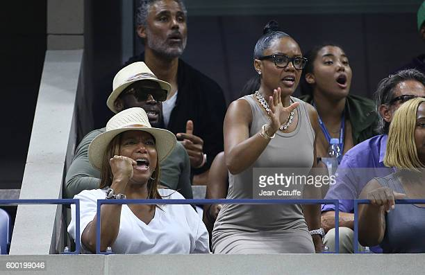 Queen Latifah and Eboni Nichols above Rick Fox and daughter Sasha Fox cheer for their friend Serena Williams during day 10 of the 2016 US Open at...