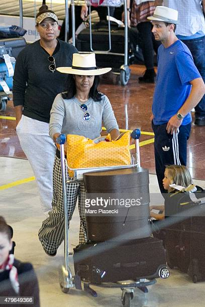 Queen Latifah and Eboni Nichols are seen at Charles-de-Gaulle airport on July 6, 2015 in Paris, France.