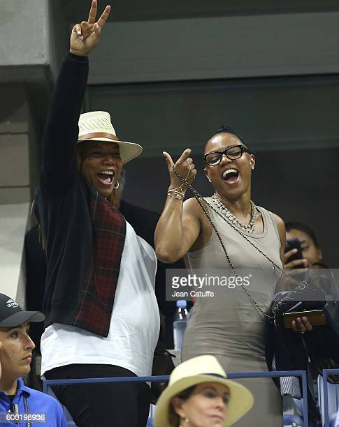 Queen Latifah and Eboni Nichols cheer for their friend Serena Williams during day 10 of the 2016 US Open at USTA Billie Jean King National Tennis...