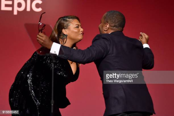 Queen Latifah and Honoree Lee Daniels embrace onstage during the 2018 amfAR Gala New York at Cipriani Wall Street on February 7 2018 in New York City