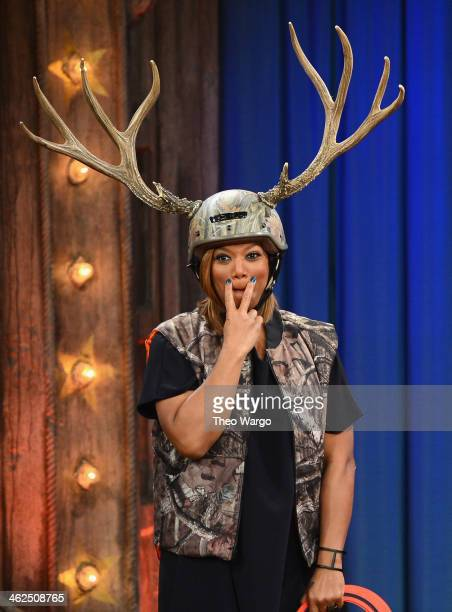 Queen Latifah and Jimmy Fallon play a game of Antler Ring Toss during a taping of Late Night With Jimmy Fallon at Rockefeller Center on January 13...