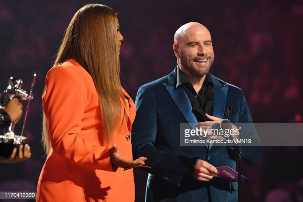 Queen Latifah and John Travolta speak onstage during the 2019 MTV Video Music Awards at Prudential Center on August 26 2019 in Newark New Jersey