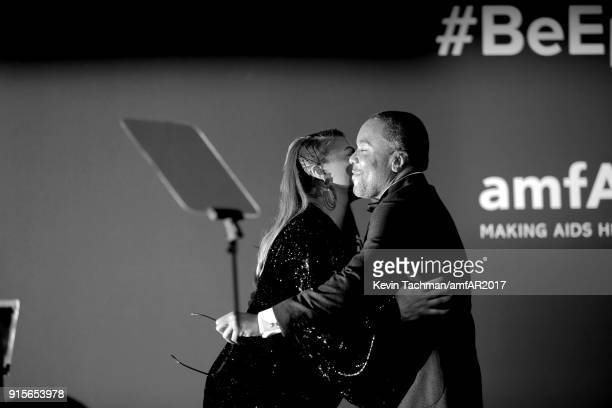 Queen Latifah and Lee Daniels speak onstage during the 2018 amfAR Gala New York at Cipriani Wall Street on February 7 2018 in New York City