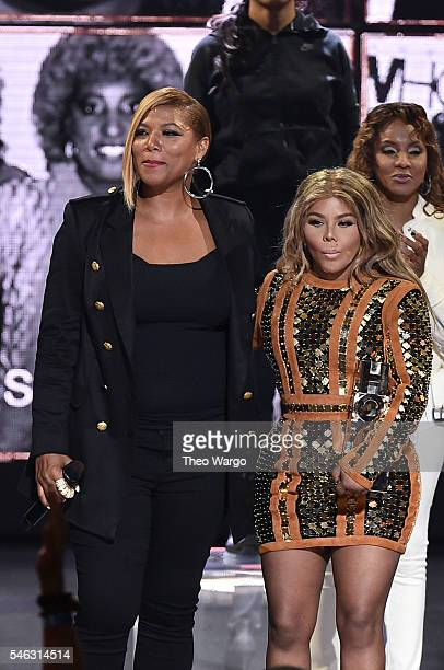 Queen Latifah and Lil Kim speak onstage during the VH1 Hip Hop Honors All Hail The Queens at David Geffen Hall on July 11 2016 in New York City