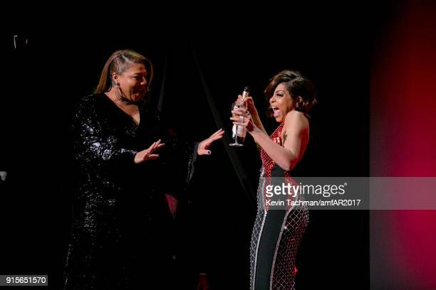 Queen Latifah and Taraji P Henson speak onstage during the 2018 amfAR Gala New York at Cipriani Wall Street on February 7 2018 in New York City