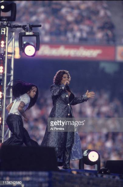 Queen Latifah performs at Halftime of the game between the Green Bay Packers and the Denver Broncos at Super Bowl 32 at Qualcomm Stadium on January...