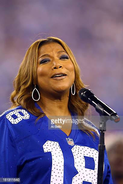 Queen Latifah performs the national anthen prior to the 2012 NFL season opener between the New York Giants and the Dallas Cowboys on September 5 2012...