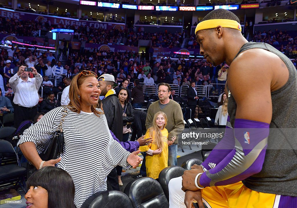 Queen Latifah (L) talks to Dwight Howard at a basketball game between the Miami Heat and the Los Angeles Lakers at Staples Center on January 17, 2013 in Los Angeles, California.