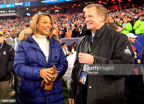 Queen Latifah talks with NFL Commissioner Roger Goodell before the Seattle Seahawks take on the Denver Broncos during Super Bowl XLVIII at MetLife...