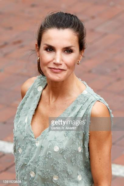 Queen Lelizia of Spain walks the Paseo de Las Canteras as the Kings hold a meeting with business union and professional representatives from the...