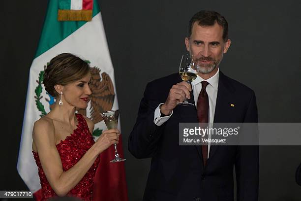 Queen Letizia and King Felipe VI of Spain make a toast during a state dinner given by Mexican President Enrique Peña Nieto and his wife First Lady...
