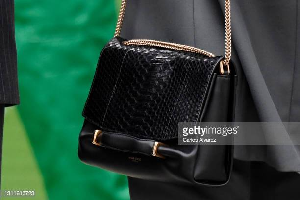 Queen Letizia, bag detail, attends the inauguration of Ibedrola's Innovation and Formation center on April 09, 2021 in San Agustin de Guadalix, Spain.