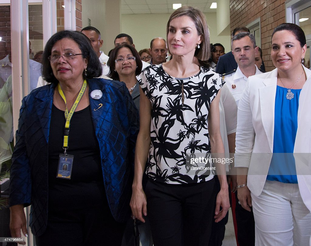 Queen Letizia (center) is accompanied by Honduras' First Lady Ana Garcia de Hernandez (right) and UNAH rector Julietta Castellanos (left) during a visit to the Universidad Nacional Autonoma, on May 26, 2015 in Tegucigalpa Honduras. Queen Letizia started a two-day visit to Honduras to supervise Spanish cooperation programs in the country.