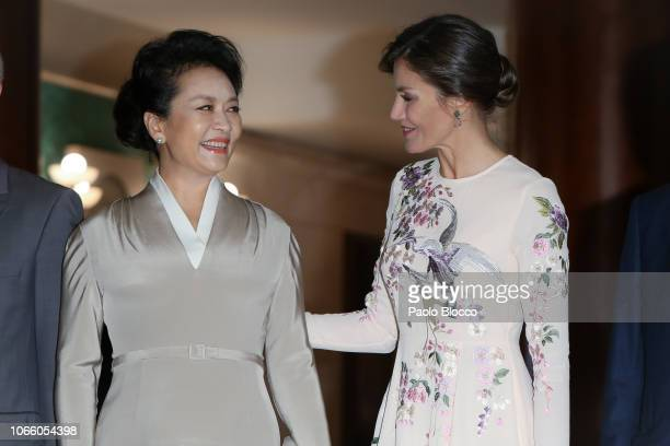 Queen Letizia of Spain and China's first lady Peng Liyuan visit the Royal Theatre on November 28, 2018 in Madrid, Spain.