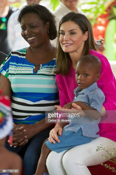 Queen Letizia of Spain and First Lady of Haiti Martine Moise visit the St Vincent de Paul Sisters College in the Cite Soleil neighborhood on May 23...
