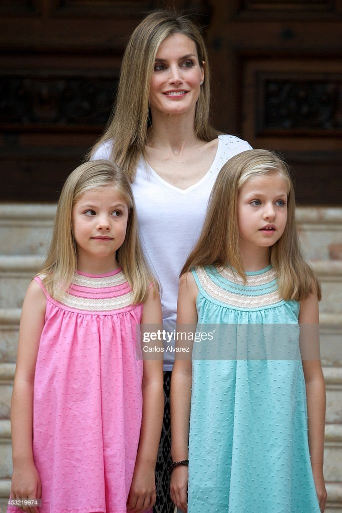 Queen Letizia of Spain (C) and her daugthers Princess Leonor of Spain (R) and Princess Sofia of Spain (L) pose for the photographers at the Marivent Palace on August 5, 2014 in Palma de Mallorca, Spain.
